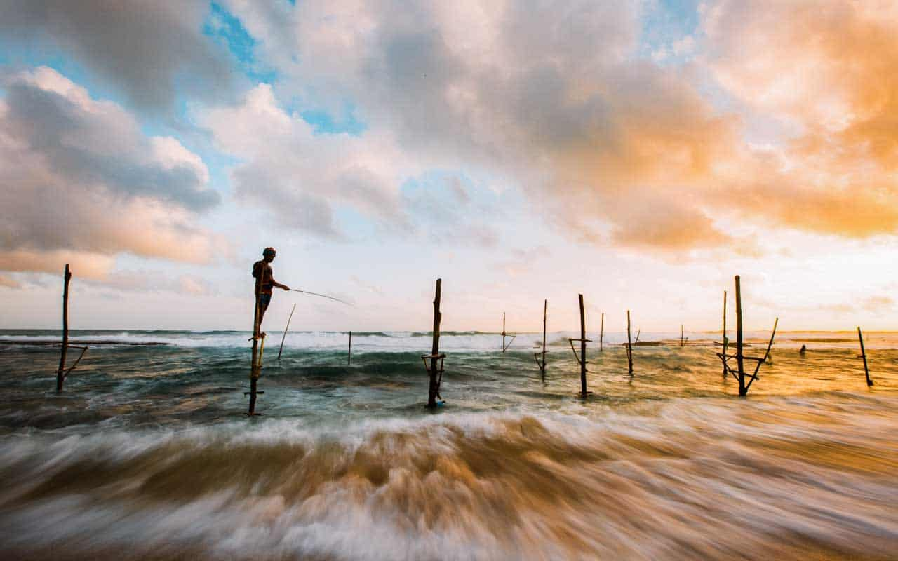 stilt-fisherman-beach-sri-lanka
